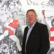 ESSEN, GERMANY - OCTOBER 02:  Horst Hrubesch, head coach of the U21 national team of Germany poses at a photo of his career as a striker of RW Essen after the Germany U21 press conference at Stadion Essen on October 2, 2014 in Essen, Germany.  (Photo by Christof Koepsel/Bongarts/Getty Images)