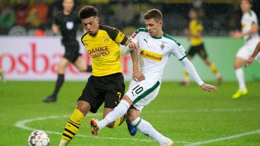 Gegner oder Teamkollegen in der kommenden Saison? Jadon Sancho von Borussia Dortmund und Gladbachs Thorgan Hazard.