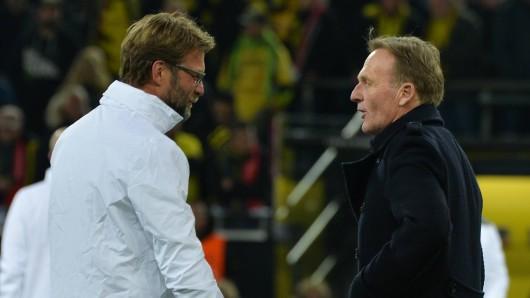 Hans-Joachi Watzke (r.) bat Jürgen Klopp, zu Borussia Dortmund zurückzukommen.