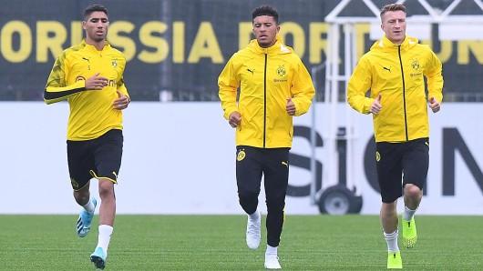 Achraf Hakimi (r.), Jadon Sancho und Marco Reus (r.) gehören zu den wertvollsten Spielern bei Borussia Dortmund.