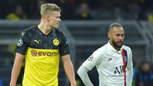 Borussia Dortmunds Stürmer Erling Haaland (l.) muss sich von PSG-Superstar Neymar verhöhnen lassen.