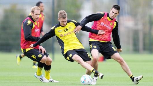 Florian Kringe (l.), Lukas Piszczek (m.) und Damien Le Tallec (r.) im Training des BVB 2009.