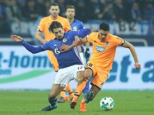 GELSENKIRCHEN, GERMANY - FEBRUARY 17: Benjamin Stambouli of Schalke (l) fights for the ball with Nadiem Amiri of Hoffenheim during the Bundesliga match between FC Schalke 04 and TSG 1899 Hoffenheim at Veltins-Arena on February 17, 2018 in Gelsenkirchen, Germany. (Photo by Christof Koepsel/Bongarts/Getty Images)