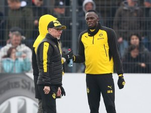 BVB-Trainer Peter Stöger mit Usain Bolt