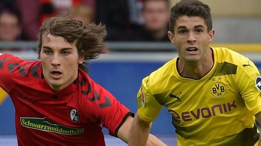 Caglar Söyüncü im Zweikampf mit Christian Pulisic von Borussia Dortmund.
