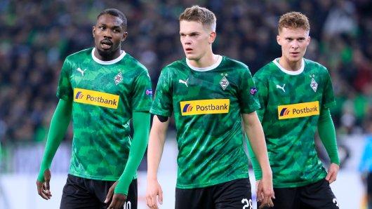 Marcus Thuram (l.), Matthias Ginter (m.) und Nico Elvedi