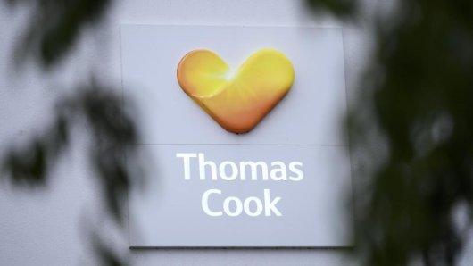 Das Logo des britischen Reisekonzerns Thomas Cook an der Zentrale des deutschen Ablegers.