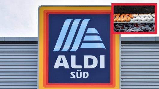 Kein Grillgenuss. Als ein Kunde Bratwürstchen von Aldi auflegen will, vergeht ihm plötzlich der Appetit.