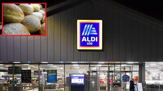 Aldi: Eine Frau kauft bei dem Discounter Berliner. (Symbolbild)