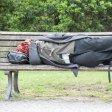 Obdachloser auf einer Parkbank am Halleschen Tor in Berlin Kreuzberg Homeless on a Park bench at Hall\u0026#39;s goal in Berlin Kreuzberg