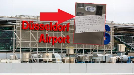 Auf einer Toilette am Flughafen Düsseldorf entdeckte ein Passagier diesen Zettel an einem Kondomautomat.