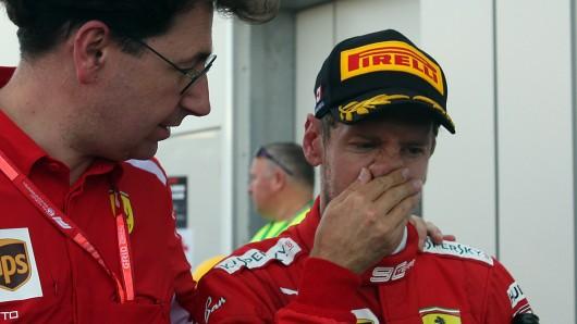 Sebastian Vettel (r.) und Ferrari-Teamchef Mattia Binotto.