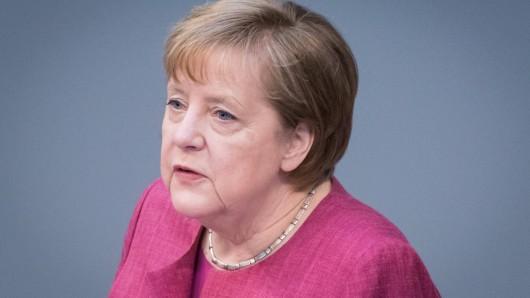 Angela Merkel spricht über mögliche Sommerurlaube 2021.